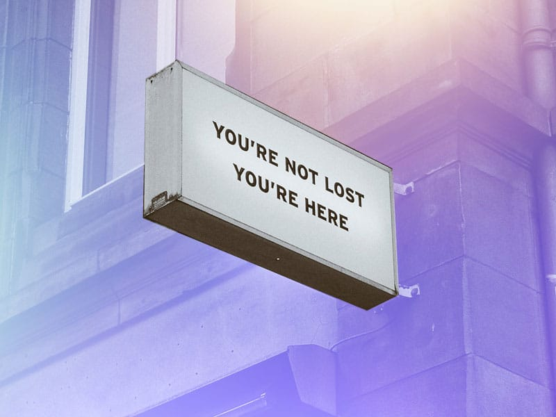 Perimenopause brain fog illustrated by a sign reading you are not lost you are here