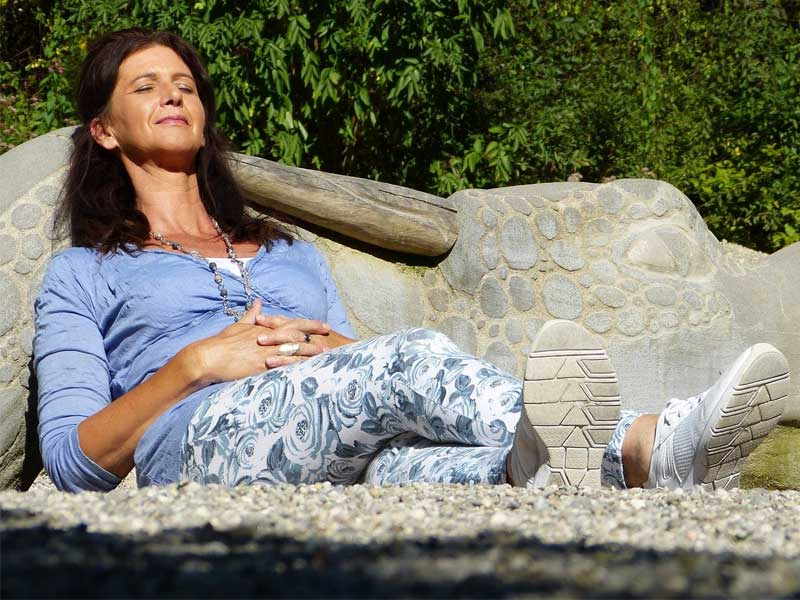 Happy, relaxed woman having enjoyed sex after menopause